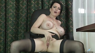 Busty mature chick Stacy Ray enjoys masturbating while home alone