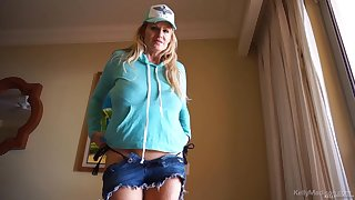 Kelly Madison takes off her shirt before close-packed on a dick