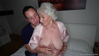 Busty mature granny Norma swallows every last drop be required of cum