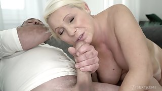 Of age blonde MILF Bibi Pink gets covered in cum after a hardcore fuck