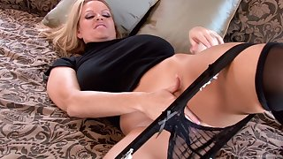 Kelly Madison wears a black apparatus via a solo experience