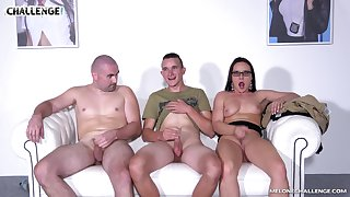 Wendy Acolyte seduces two guys and sucks their cocks on the couch