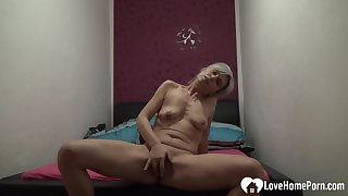 Tempting solo girl pleasuring her tight snatch